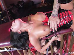 Asa Akira gets pummeled on top of a encaged Sophia Santi