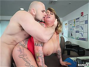 hefty titted Brandy Talore juggling on a phat man rod