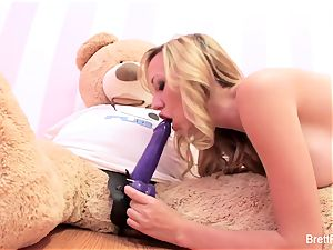 Brett Rossi plays with a stuffed bear's strap-on fake penis