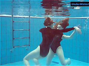 two red-hot teenagers underwater