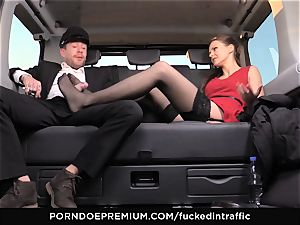 boinked IN TRAFFIC Tina Kay footjob in the backseat