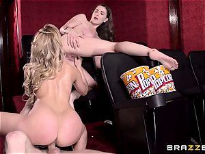 Cherie Deville and Molly Jane smash fuck-stick in a porno theatre