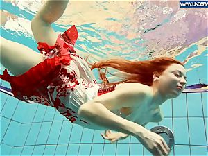 steaming polish red-haired swimming in the pool