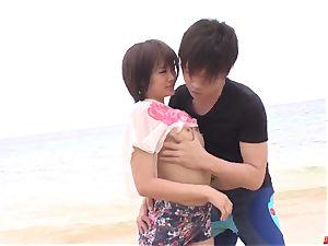 Saya Tachibana lovemaking at the beach with a nasty stud