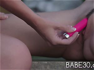 Rainbow faux-cock girl/girl orgasms Outdoors