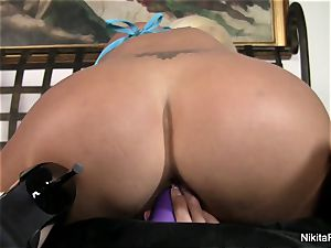 steamy platinum-blonde Nikita plays with a purple plaything