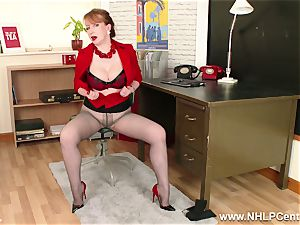 ginger-haired cougar thumbs labia on office desk in tights